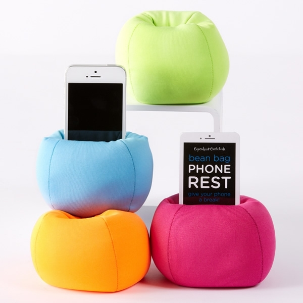 Bean Bag iPhone Stand. As its name suggests, this iPhone stand features a comfy bean bag to display your device in bright color.