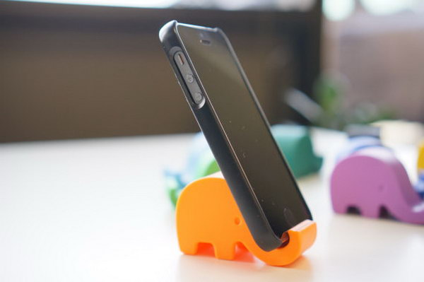 Cute Elephant iPhone Stand. As its name suggests, this stand features an adorable elephant iPhone stand to display your device in a funny way.
