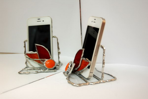 Stained Glass iPhone Stand. Use transparent glass to create this stained glass iPhone stand decorated with flower with orange red touches pieces of glass.