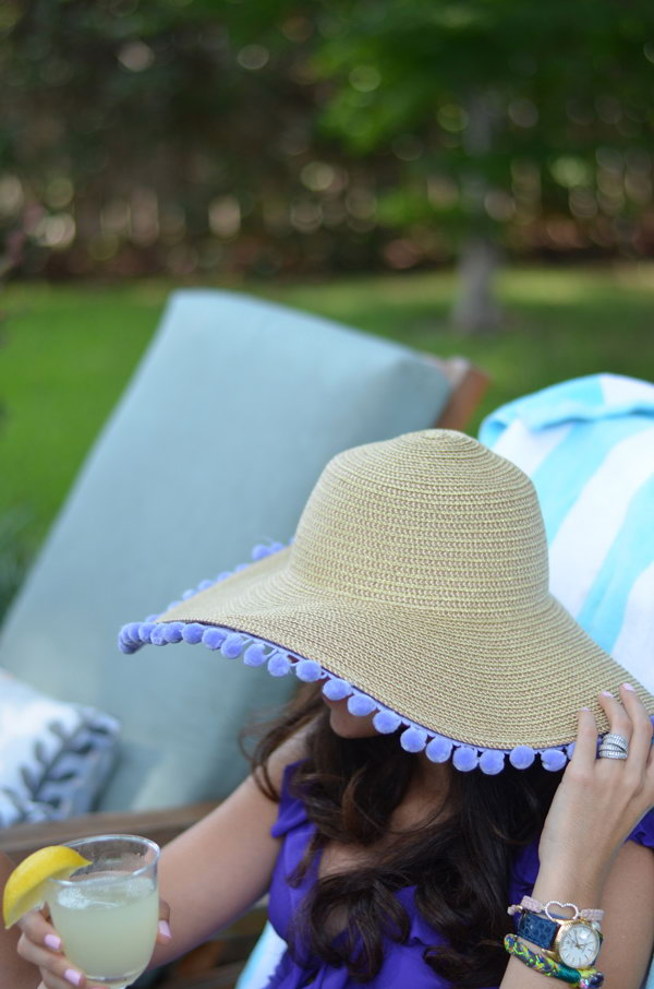 DIY Pom Pom Sun Hat. I love the cute pompoms very much and this is a fun pom pom hat tutorial.