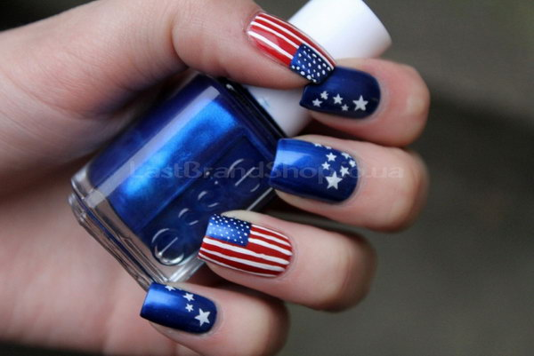 Classic Stars and Stripes Nail Art: What makes this classic stars and stripes manicure look textural and fancy is the electro opt blue they used and the length of the nails. I am forever trying to get my nails the same length so I can try something cool like this.
