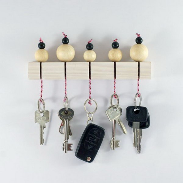 DIY Key Holder With Wooden Beads. Keys are always laying around, so having one central location with a little extra cuteness is a win win!  Check out and create one super cute wooden beads key holder like this for your own
