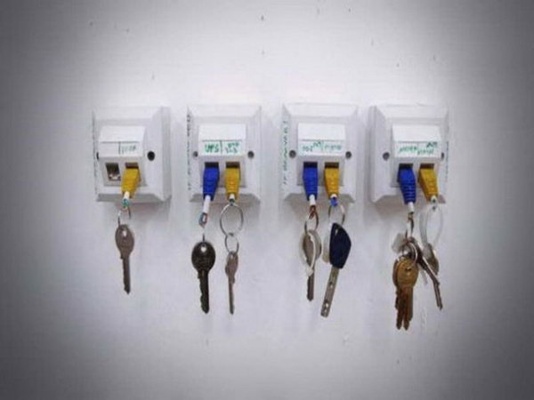 Geeky USB Cable Key Holder. This key holder is  made from several wall mounted  RJ 45 jack network boxes. It's quick and ingenious, and most of all, all your keys will be exactly where you have left them. Get more inspiration