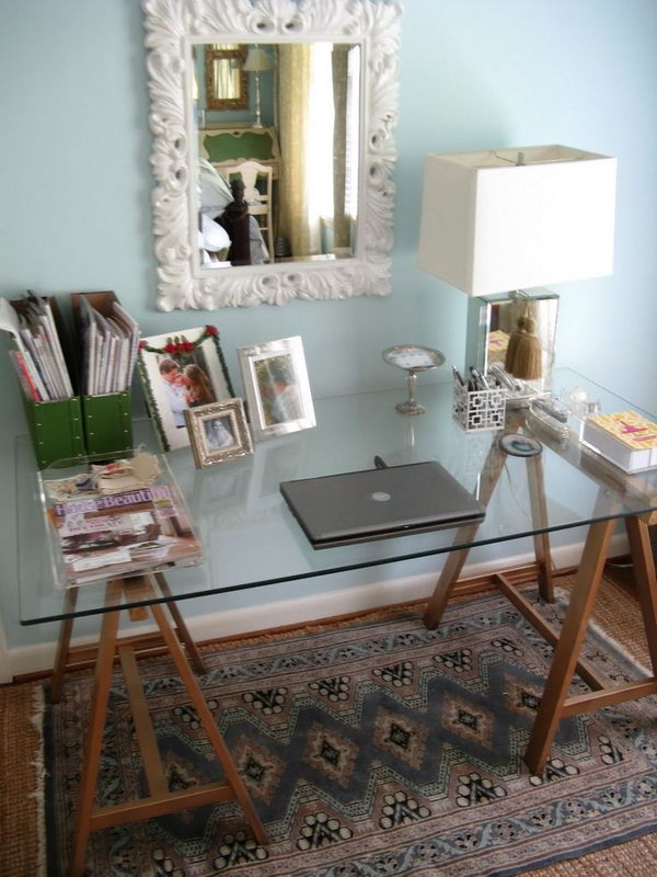 DIY Sawhorse Desk. This DIY sawhorse desk is not only classic but chic, especially with a glass top. Get the tutorial
