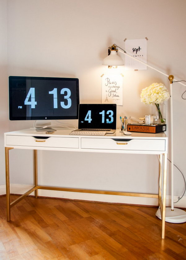 The Midas Touch Desk Hack. A standard, white IKEA desk was transformed using gold spray paint on the desk legs and gold drawer pull handles. See the full tutorial