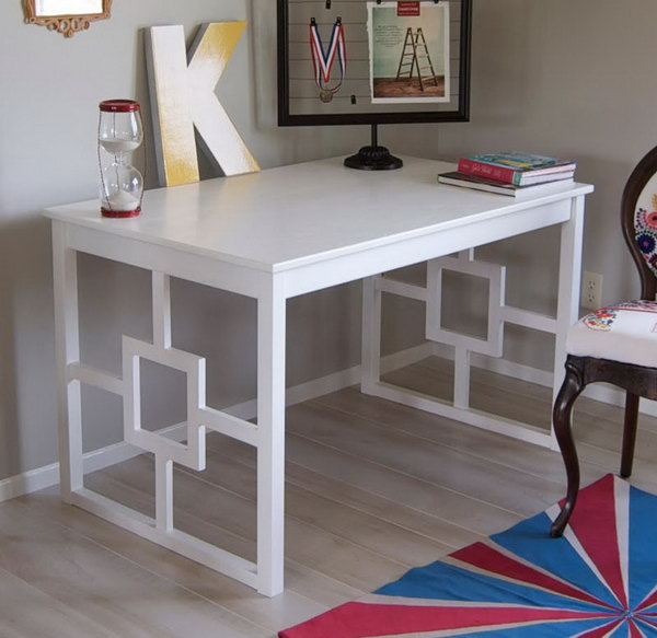 IKEA Chic Modern Desk. See how Katie turned a basic and unfinished IKEA Ingo dining table into a beautiful, chic modern desk with some white paint and a little bit of puzzling together at Matsutake blog.