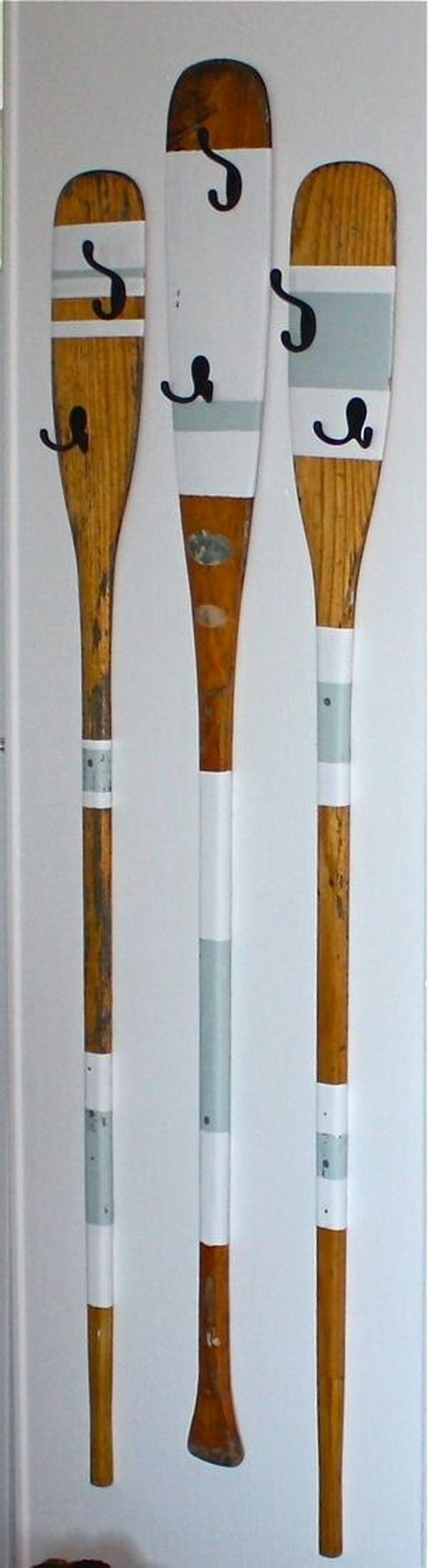Upcycled Rowing Oars into Coat Hangers.