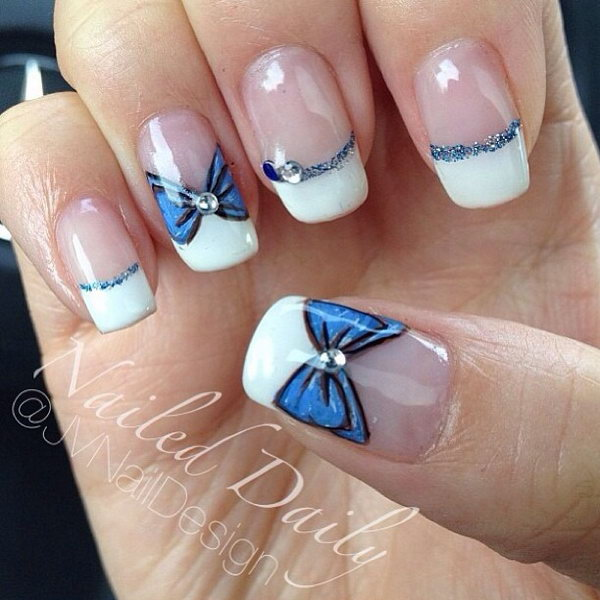 White Tips Nail Design with Blue Bows.