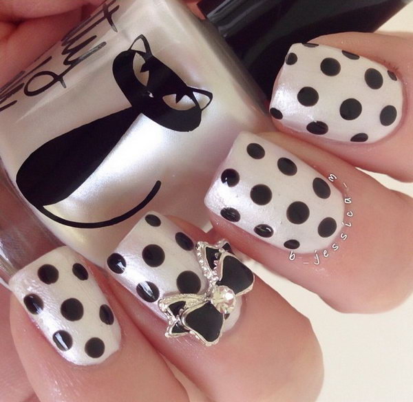 Pearl and Black Polka Dot Nails With Black and Silver Bow.