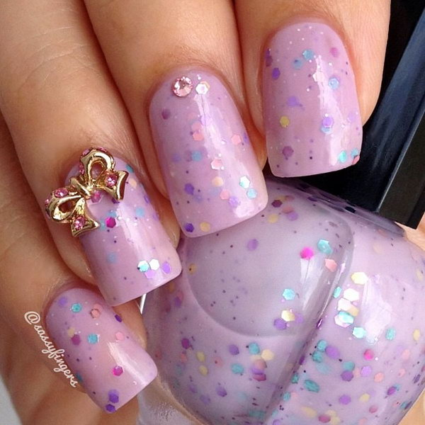 Pink and Sequined Nail with Gold Bows.