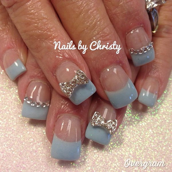 Light Blue and White Nails with Sparkly Bows.