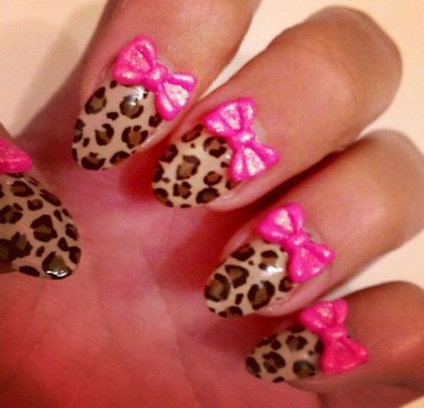 Animal Print Nail Design with Pink Bows.