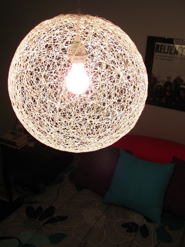 DIY String Chandelier from a Bouncy Ball and Yarn.