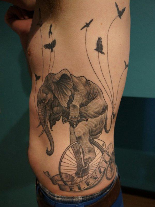 Fun Elephant Acrobatics Tattoo.