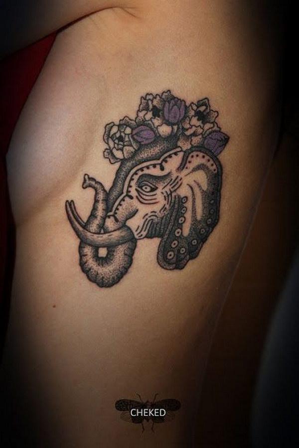 Elephant and Flowers Elephant Rib Tattoo.