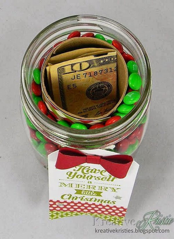 Fun Way to Give Cash. Cut and cover a toilet paper or paper towel roll with decorative paper. Center in a jar and fill in around the roll with favorite candy. Nestle money or other small gifts inside.