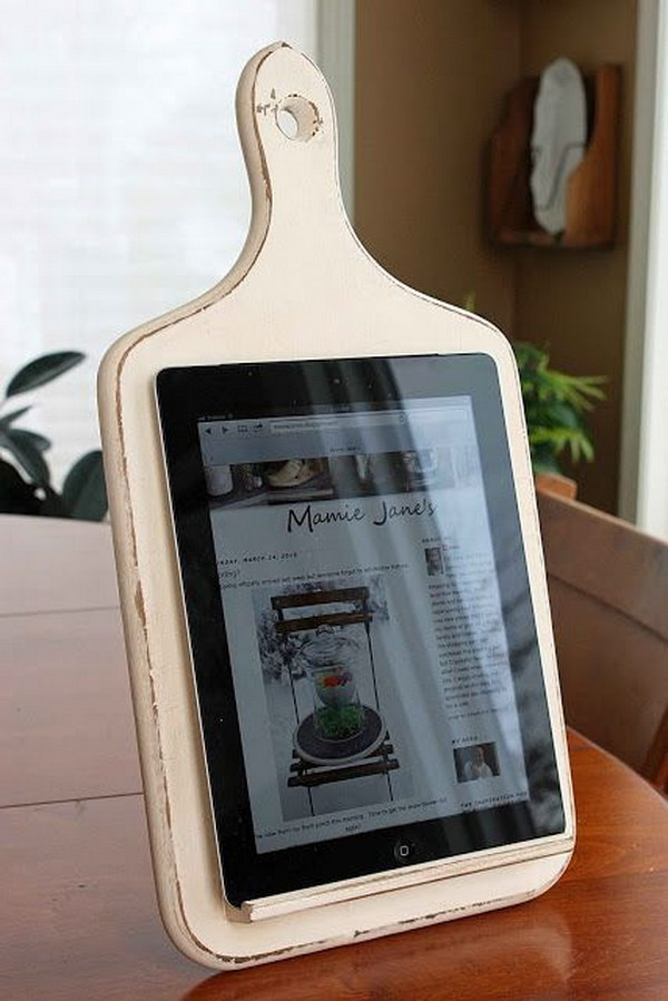 Kitchen Tablet Holder. This was made from an old wooden kitchen board. So cool for the kitchen  while trying to follow recipes online. A great gift for your mom or other hostess friends.