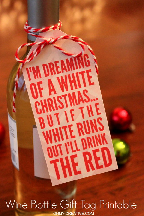 Christmas Wine Bottle Gift. A bottle of wine with a free printable gift tag makes a really simple and sweet gift idea and sure to bring a smile to the hostess!