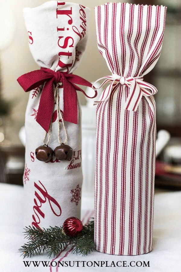Wine Hostess Gifts. Simple wrap a wine bottle in a festive tea towel!