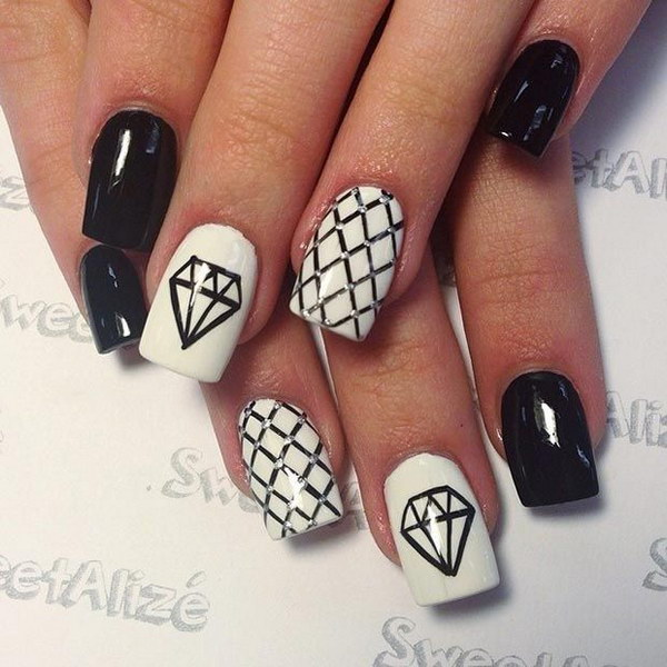 Black and White Nail Design with Diamonds