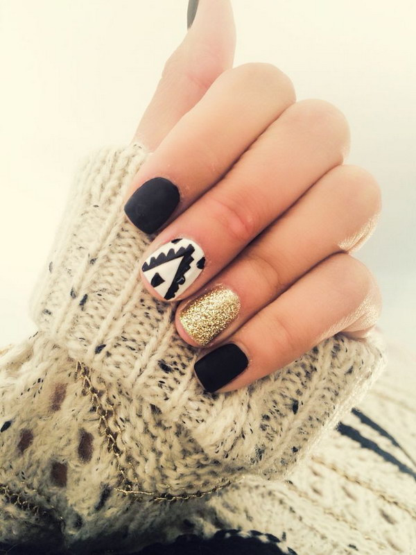 Fancy Black and White Nails with Gold Glitter Accent