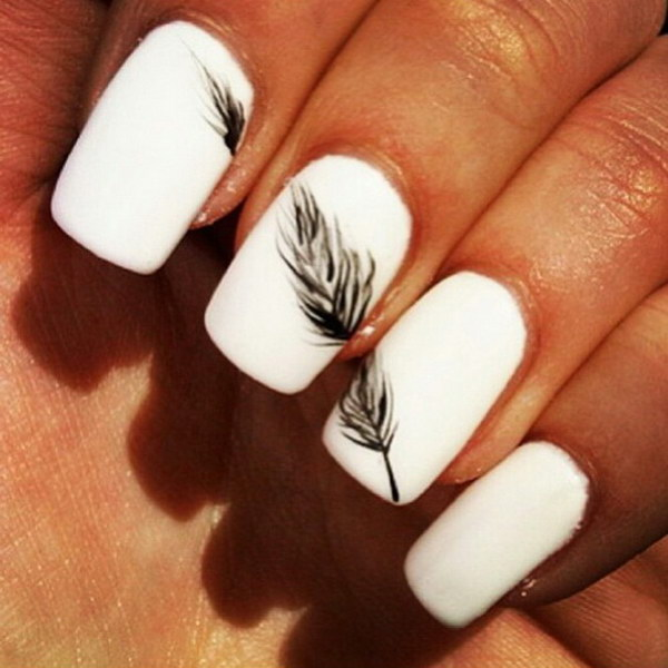 White Nails with a Black Feather