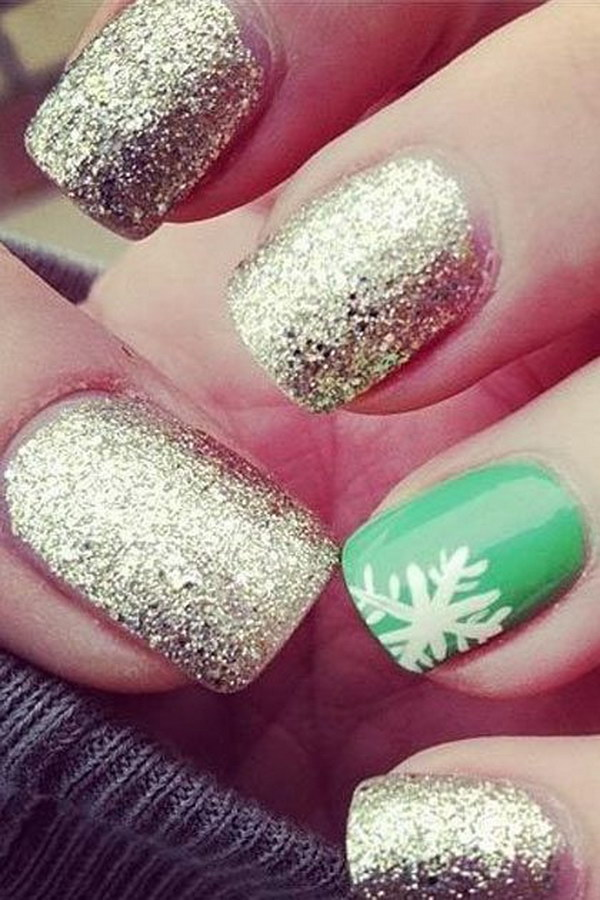 SnowFlake on Green Background and Golden Glitter Nails.
