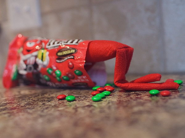 Candy Crazy. he poor elf stuck his head all in the candy bag. This would be a great party centerpiece idea.