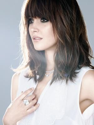 Should Length Dark Brown Layered Hair with Thick Bangs.
