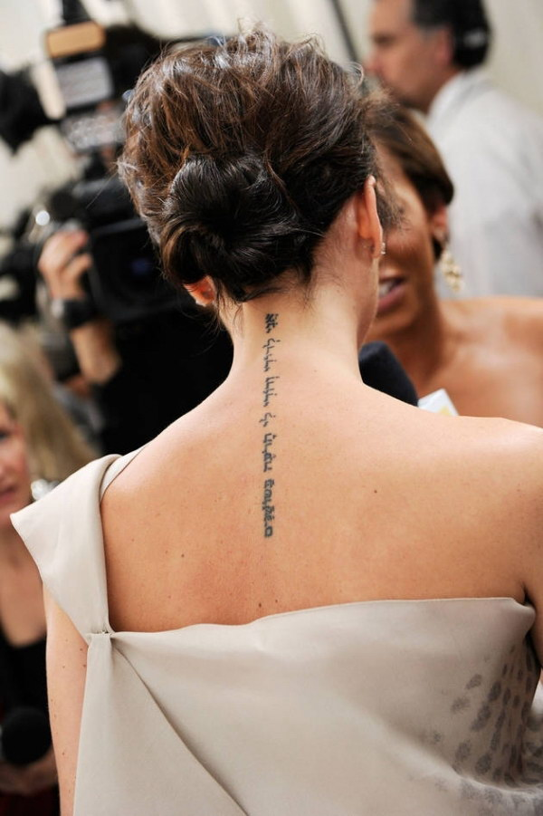 Victoria Beckham Back of Neck Tattoo
