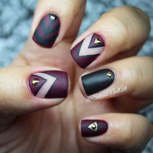 Dark Matte Nail Design with Gold Details.
