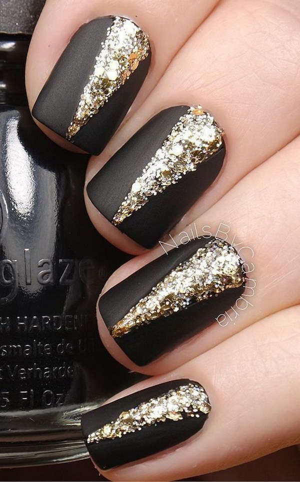 Black Matte Nail Polish with Gold Embellishments on Top.
