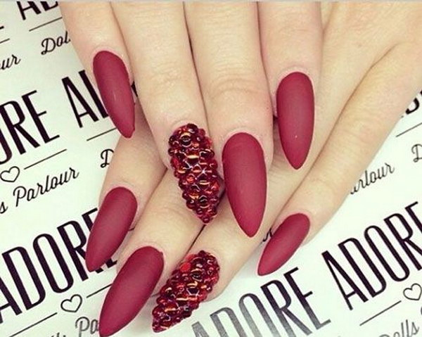 Red Matte Stiletto Nails with Crystals.