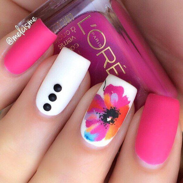 Pink and White Nails with Buttons and a Flower Details.