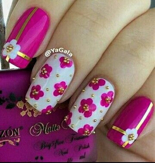 White, Pink Flower Nail Polish Design with Gold Studs.