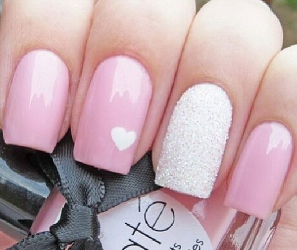 Pink Base Nail with Small White Heart on Top.