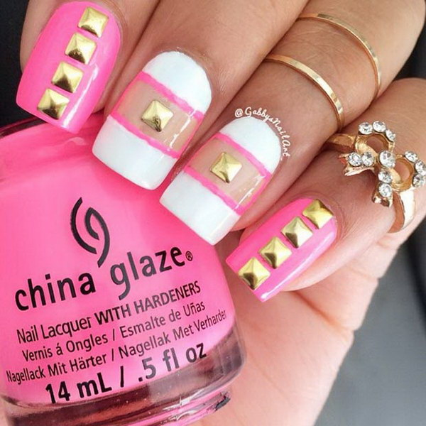 Pink And White Nails With Gold Studs.