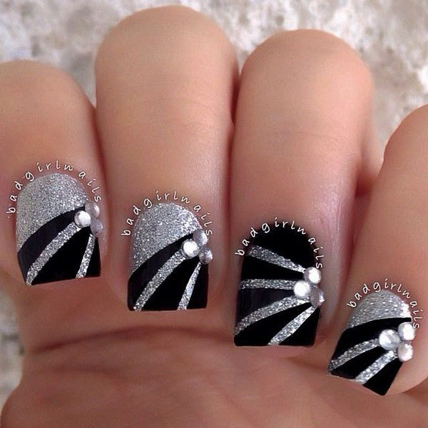Black Nail Design with White Glitter and Gem Details.