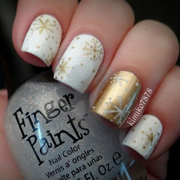 White & Gold Nails with Fire Works for Detail.
