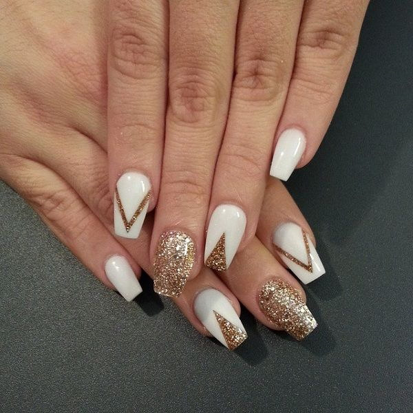 White and Gold Glitter Nail Art Design in V shapes.