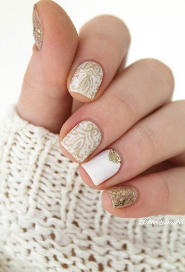 White and Gold Baroque Nail Design.