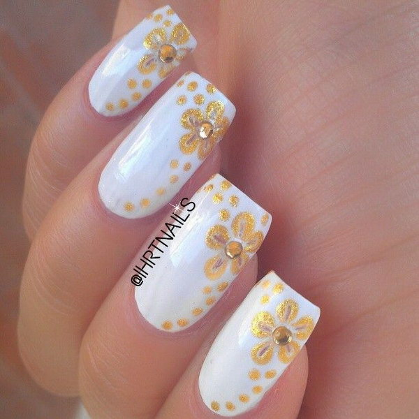 White And Gold Floral Nail Design.