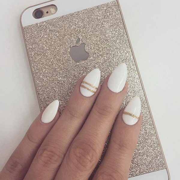 White and Gold Pointed Oval Nails.