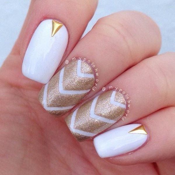 White and Gold Strips Nail Design.