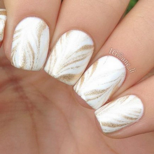White and Gold Water Marbling Nail Design.