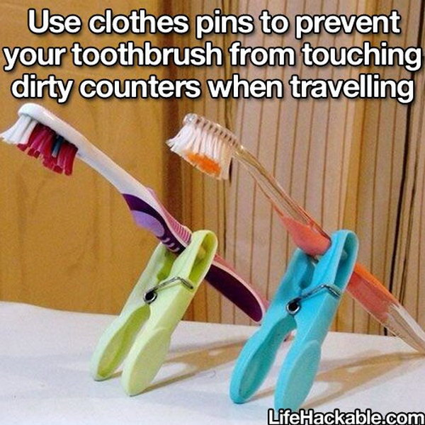 Keep Toothbrushes off Dirty Counters with Clothes Pins When Travelling.