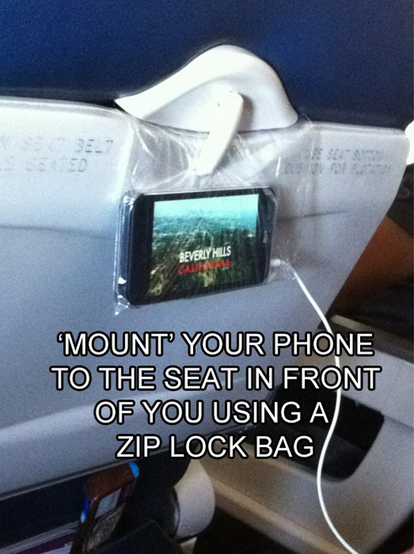 Use a Plastic Bag to Create Your Own in-flight Viewing Experience. Mount Your Phone to the Seat in Front of You Using A Zip Lock Bag.