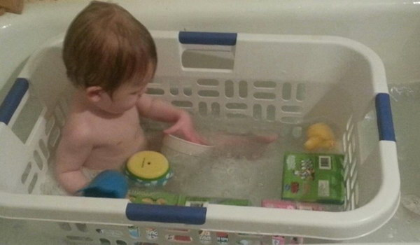 Bath Your Child in a Laundry Basket So That Their Toys Don't Float Away.