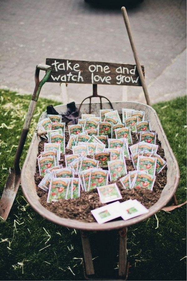 """TAKE ONE AND WATCH LOVE GROW"" Seed Packet Wedding Favors in a Wheelbarrow"