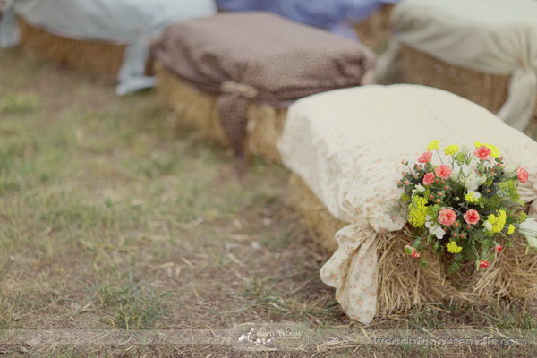 Hay Bale Wedding Seating with Fabric and Flower Decoration